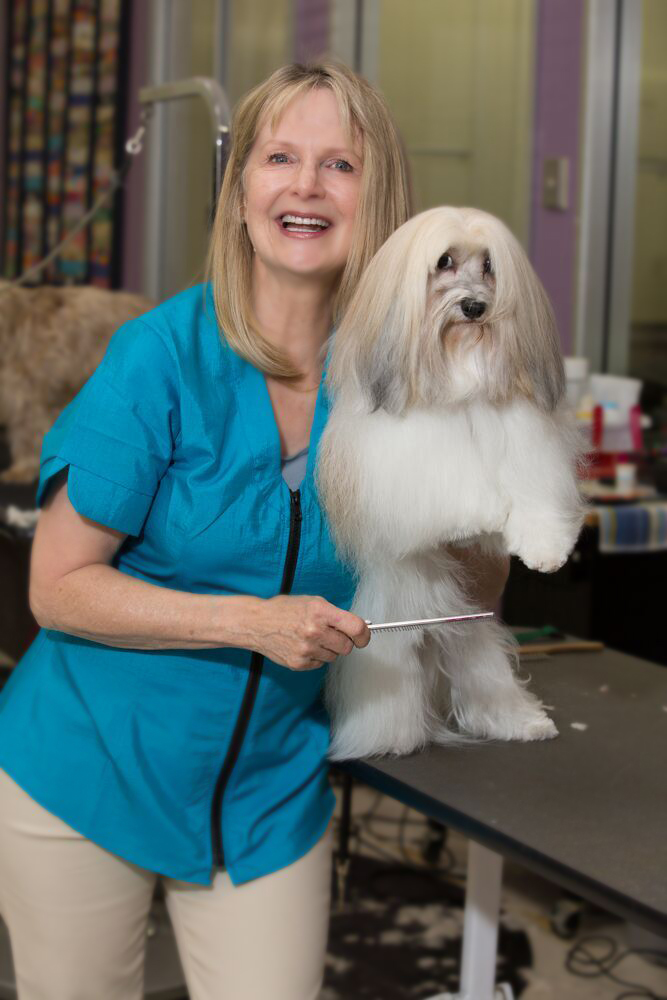 Linda with her dog getting styled